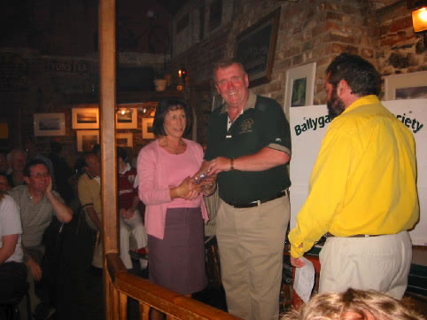 Phyllis Hobdell receiving her prize on Captain's Day 2002