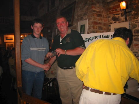 Captains Day 2002. Dermot Hobbs Presents a prize to Martin Lacey Jnr