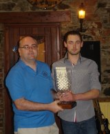 Andrew Lacey presents the Martin Lacey perpetual Trophy to the clubman of the year PJ Naughter