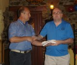 PJ accepts a prize on behalf of Lester Horgan