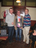 The overall winner receiving his prize from the sponsor Brendan Malone and Captain John Wafer